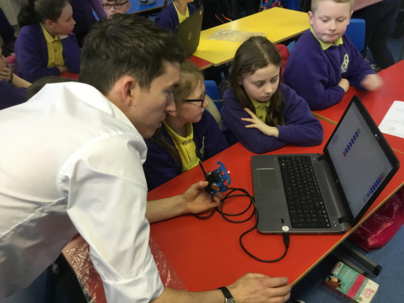 Conor Sloane from SentinusNI teaching Mrs Galligans's P6 class to programme Microbots.