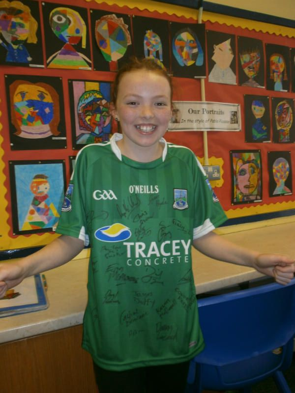 Mya, winner of the GAA Feile art competition, shows off her signed Fermanagh jersey
