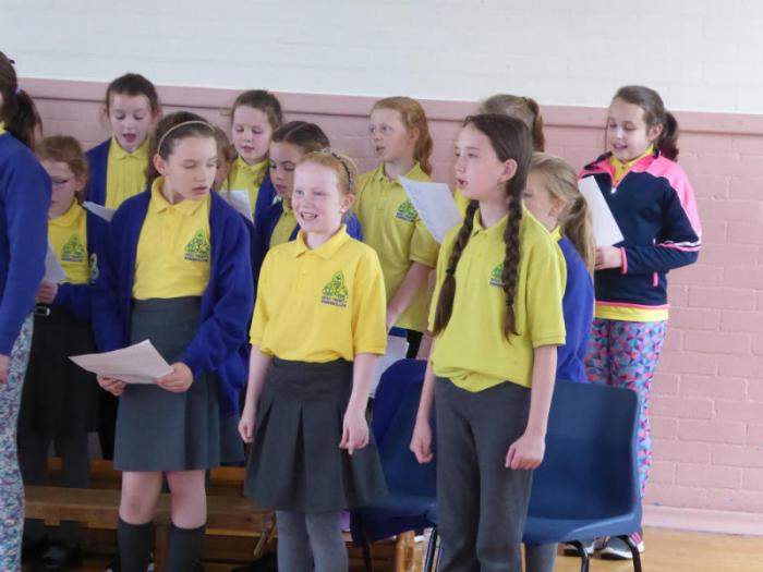 KS2 choir practicing for the school mass