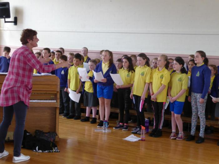 Mrs Kirke takes the KS2 choir for practice.