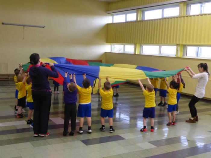Mrs McDonnell's class enjoy doing the actions to songs with the parachute