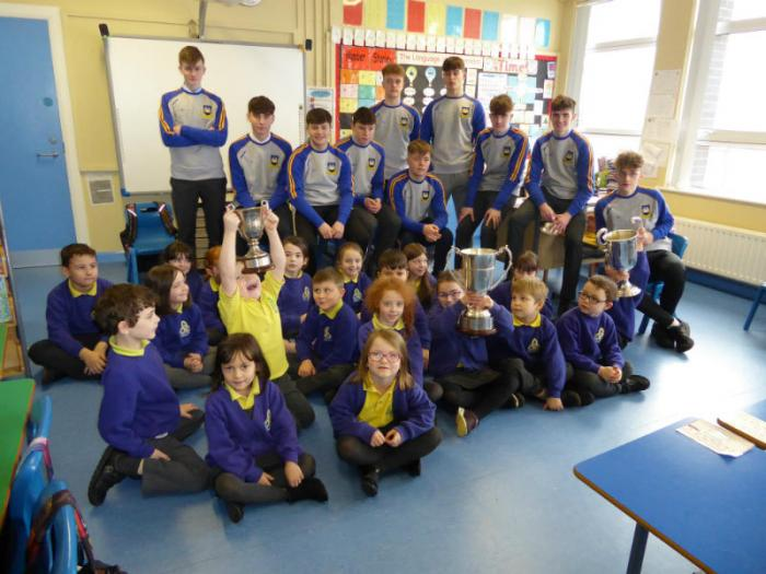 Pupils enjoy a visit from the Enniskillen Gaels U21 Minor Champions