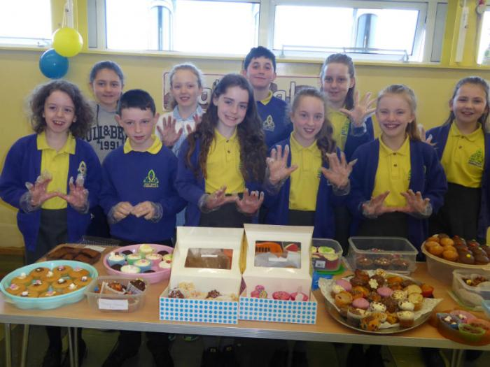 Children from KS1 & KS2 -ready for the cake sale to begin at Mill Street