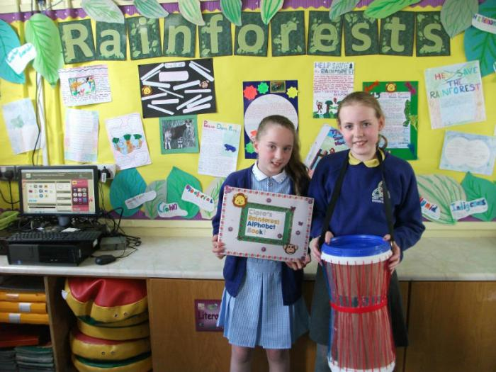 Ciara & Shannon show off their beautiful Takeaway Homework pieces which they made as part of their Rainforest Topic.