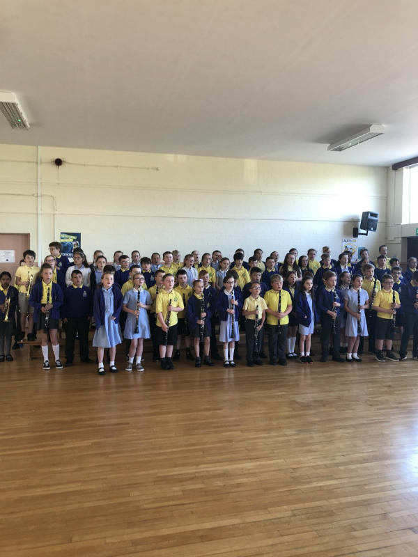P5 children practice for their end of year concert